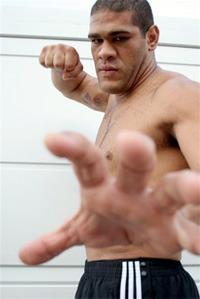 Bigfoot Silva uses his massive fists to finish Mike Kyle