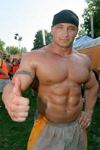 Mariusz has a music video to go with his gargantuan arms
