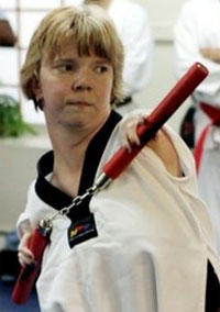 Woman with no arms or kneecaps prepares for her black belt