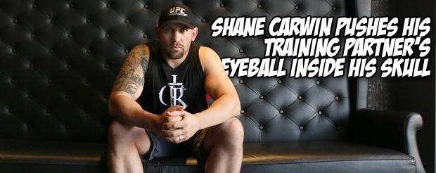 Shane Carwin pushes his training partner's eyeball inside his skull