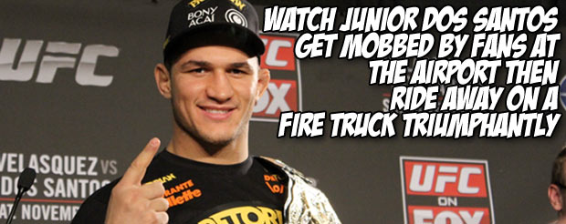 Watch Junior Dos Santos get mobbed by fans at the airport then ride away on a fire truck triumphantly