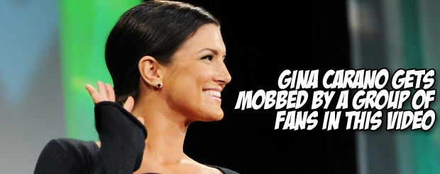 Gina Carano gets mobbed by a group of fans in this video