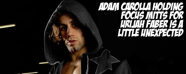 Adam Carolla holding focus mitts for Urijah Faber is a little unexpected