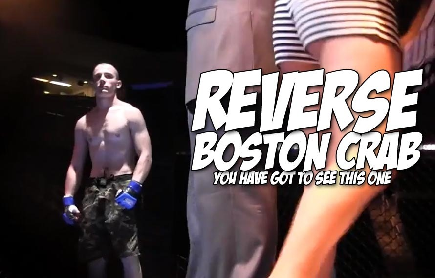 Guy wins MMA fight with a reverse Boston crab, off his BACK!