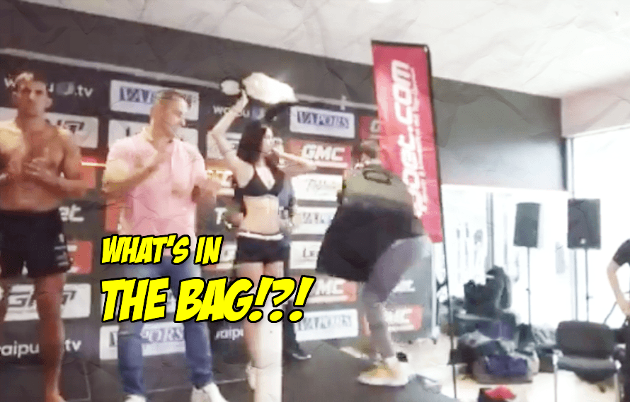 Video: Fighter shows up to the weigh-ins with a midget in a bag to psych out opponent