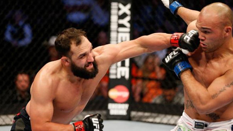 Johny-Hendricks-Outlast-Robbie-Lawler-at-UFC-171 Johny Hendricks
