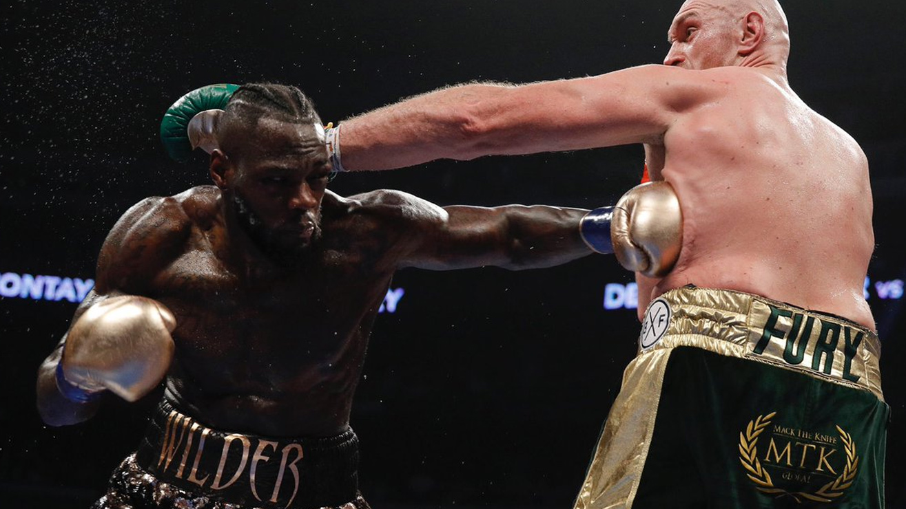 Highlights: Deontay Wilder Retains His Title Via Split Draw With Tyson Fury