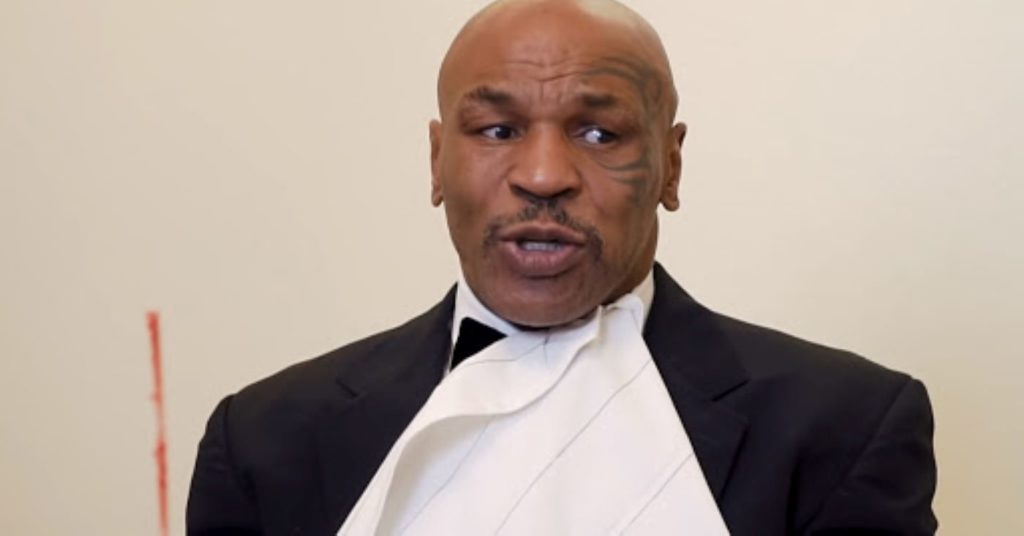 Mike Tyson Eats Ear Off Roy Jones Jr Cake Ahead of Their Exibition Bout (Video)